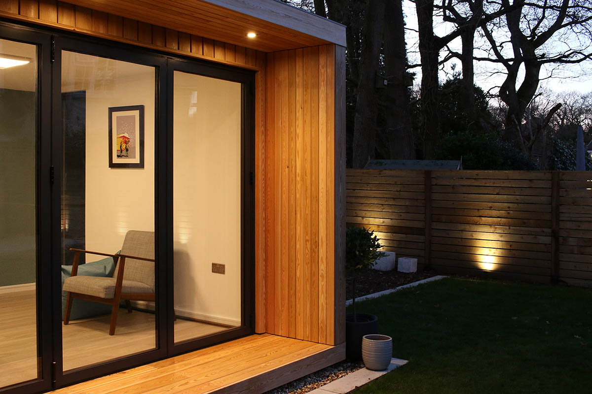 Garden room with Siberian larch cladding and canopy